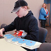 Brandon Epey, 14, uses his dueling disk to play Yu-Gi-Oh! game against Noah Parko, 11, during the Yu-Gi-Oh! tournament at Mamie Doud Eisenhower Public Library on Tuesday.<br /> November 23, 2010<br /> staff photo/David R. Jennings