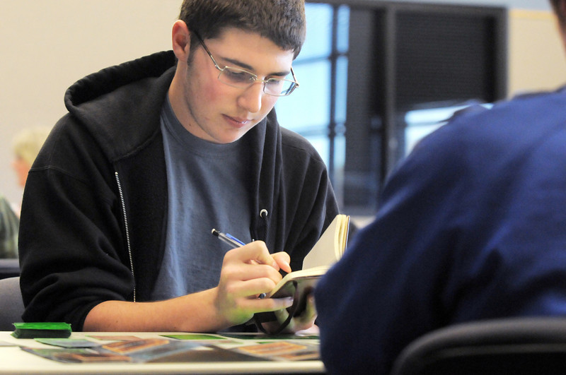 Josh Gruener, 16, adds up points while playing a game against Axl Raditz, 14, during the Yu-Gi-Oh! tournament at Mamie Doud Eisenhower Public Library on Tuesday.<br /> November 23, 2010<br /> staff photo/David R. Jennings