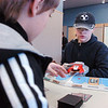 Brandon Epey, 14, uses his dueling disk to play a Yu-Gi-Oh! game against Noah Parko, 11, during the Yu-Gi-Oh! tournament at Mamie Doud Eisenhower Public Library on Tuesday.<br /> November 23, 2010<br /> staff photo/David R. Jennings