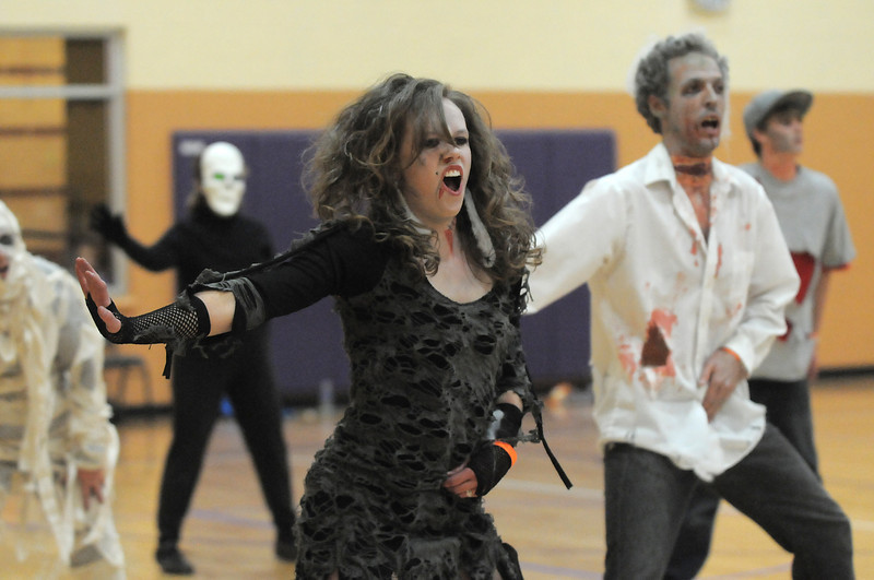 """Janell Durnen, right, and Ean Biggs dance to Michael Jackson's Thriller with 100 other """"zombies"""" at the Paul Derda Recreation Center on Saturday as a fundraiser for A Precious Child. <br /> October 29, 2011<br /> staff photo/ David R. Jennings"""