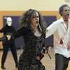 "Janell Durnen, right, and Ean Biggs dance to Michael Jackson's Thriller with 100 other ""zombies"" at the Paul Derda Recreation Center on Saturday as a fundraiser for A Precious Child. <br /> October 29, 2011<br /> staff photo/ David R. Jennings"