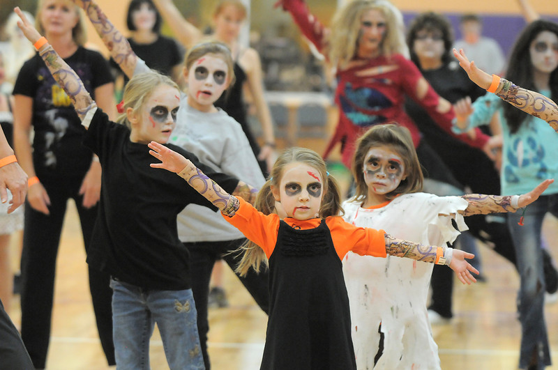 "Lexie Fehr, 5, center, dances with 100 ""zombies"" at the Paul Derda Recreation Center on Saturday to perform Michael Jackson's Thriller dance as a fundriaser for A Precious Child.<br /> October 29, 2011<br /> staff photo/ David R. Jennings"