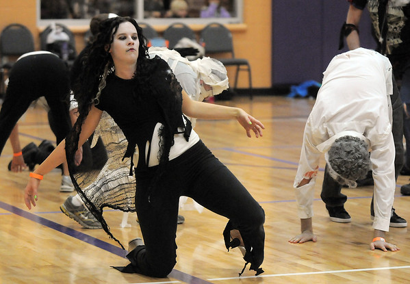 "Denise Brozovich dances with 100 ""zombies"" for Michael Jackson's Thriller at the Paul Derda Recreation Center on Saturday as a fundriaser for A Precious Child..<br /> October 29, 2011<br /> staff photo/ David R. Jennings"