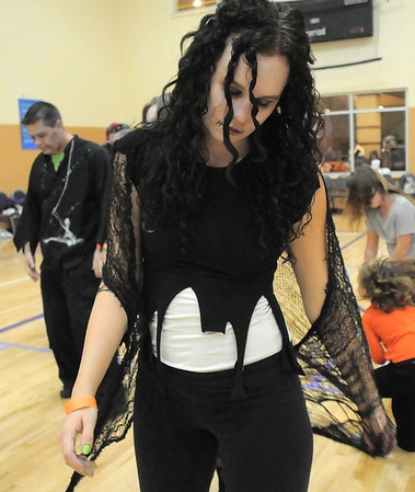"Denise Brozovich dances to Michael Jackson's Thriller with 100 other ""zombies"" at the Paul Derda Recreation Center on Saturday as a fundraiser for A Precious Child. <br /> October 29, 2011<br /> staff photo/ David R. Jennings"