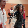 "Janell Durnen dances to Michael Jackson's Thriller with 100 other ""zombies"" at the Paul Derda Recreation Center on Saturday as a fundraiser for A Precious Child. <br /> October 29, 2011<br /> staff photo/ David R. Jennings"