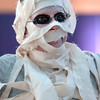 "Cheryl Thompson, dressed as a mummy, dances to Michael Jackson's Thriller with 100 other ""zombies"" at the Paul Derda Recreation Center on Saturday as a fundraiser for A Precious Child. <br /> October 29, 2011<br /> staff photo/ David R. Jennings"
