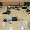 "The 100 ""zombies"" lay on the floor at the Paul Derda Recreation Center on Saturday to perform Michael Jackson's Thriller dance as a fundriaser for A Precious Child.<br /> October 29, 2011<br /> staff photo/ David R. Jennings"