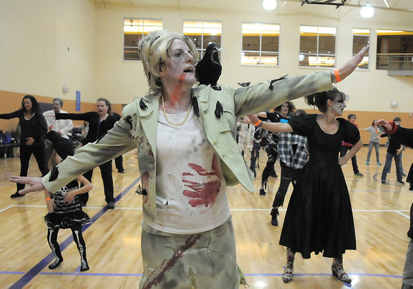 "Peggy Ganse, dressed as a character from the movie The Birds,  dances to Michael Jackson's Thriller with 100 other ""zombies"" at the Paul Derda Recreation Center on Saturday as a fundraiser for A Precious Child. <br /> October 29, 2011<br /> staff photo/ David R. Jennings"