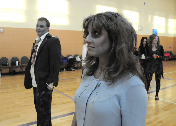 "Elena Jaramillo and Jason Graham dance to Michael Jackson's Thriller with 100 other ""zombies"" at the Paul Derda Recreation Center on Saturday as a fundraiser for A Precious Child. <br /> October 29, 2011<br /> staff photo/ David R. Jennings"