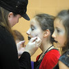 Maraena Ortiz, 12, gets a touch up of her zombie makeup by her  mother Cindy for Michael Jackson's Thriller dance at the Paul Derda Recreation Center on Saturday as a fundriaser for A Precious Child.<br /> October 29, 2011<br /> staff photo/ David R. Jennings