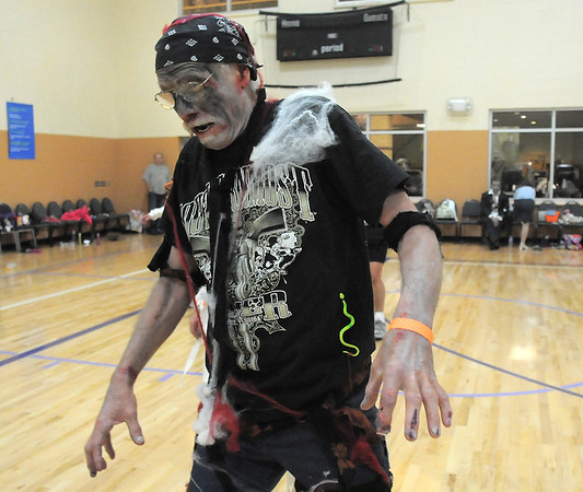 "Mitch Herring moves like a zombie while dancing to Michael Jackson's Thriller with 100 other ""zombies"" at the Paul Derda Recreation Center on Saturday as a fundraiser for A Precious Child. <br /> October 29, 2011<br /> staff photo/ David R. Jennings"