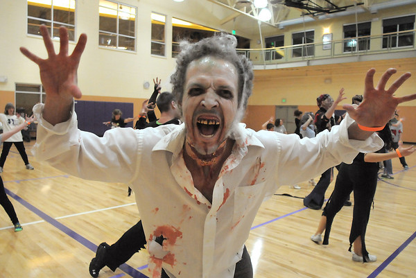 "Ean Biggs does a scary move while joining 100 ""zombies"" at the Paul Derda Recreation Center on Saturday to perform Michael Jackson's Thriller dance as a fundriaser for A Precious Child.<br /> October 29, 2011<br /> staff photo/ David R. Jennings"