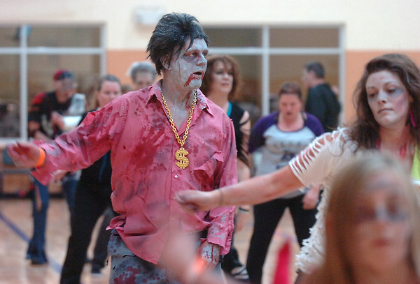 "Liv Bowden dances to Michael Jackson's Thriller with 100 other ""zombies"" at the Paul Derda Recreation Center on Saturday as a fundraiser for A Precious Child. <br /> October 29, 2011<br /> staff photo/ David R. Jennings"