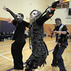 "Janell Durnen dances with her husband Dustin, left, and Mitch Herring to Michael Jackson's Thriller joining 100 ""zombies"" at the Paul Derda Recreation Center on Saturday a fundriaser for A Precious Child.<br /> October 29, 2011<br /> staff photo/ David R. Jennings"