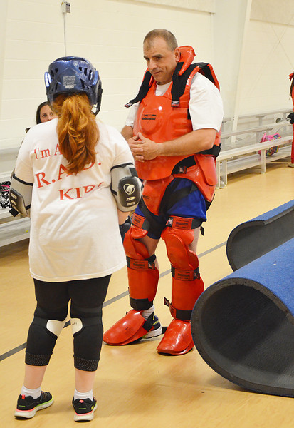Leominster Police Officer Mike Salovardos suits up for the RAD Training at the Leominster Boys & Girls Club on Friday afternoon. SENTINEL & ENTERPRISE / Ashley Green