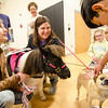 Kaylee and Kris Amons, along with therapy horse Gypsy, teach kids about the financial responsibilites of having a pet during the Reality Fair at the Leominster Boys and Girls Club on Wednesday afternoon. SENTINEL & ENTERPRISE / Ashley Green