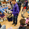 Sally Cragin teaches Anthony Garcia, 12, about the financial responsibilities of having a pet during the Reality Fair at the Leominster Boys and Girls Club on Wednesday afternoon. SENTINEL & ENTERPRISE / Ashley Green