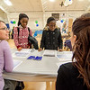 Brianna Boateng, 11, and Tiffany Boasiako, 12, talk to Kelly Johnson, from DCU and Elisa Gonzalez, from IC Credit Union, about their finances during the Reality Fair at the Leominster Boys and Girls Club on Wednesday afternoon. SENTINEL & ENTERPRISE / Ashley Green