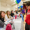 Kelley DeWolf, from Leominster Credit Union, teaches Jonathan Arel, 14, about student loans during the Reality Fair at the Leominster Boys and Girls Club on Wednesday afternoon. SENTINEL & ENTERPRISE / Ashley Green
