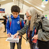 Patti Davenport helps Bruno Leite, 12, with his finances during the Reality Fair at the Leominster Boys and Girls Club on Wednesday afternoon. SENTINEL & ENTERPRISE / Ashley Green
