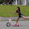 JUly 21, 2021 -- River's Edge on the Concord, in Lowell, where construction of single family and duplex houses began in 2006. Sonita Sok, 5, of Lowell, rides a scooter around Adie Way, where her aunt lives and she visits.  SUN/Julia Malakie