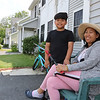 JUly 21, 2021 -- River's Edge on the Concord, in Lowell, where construction of single family and duplex houses began in 2006.  Sophea Han of Lowell, a five-year resident of Adie Way, with her son Ivan Sor, 10. SUN/Julia Malakie