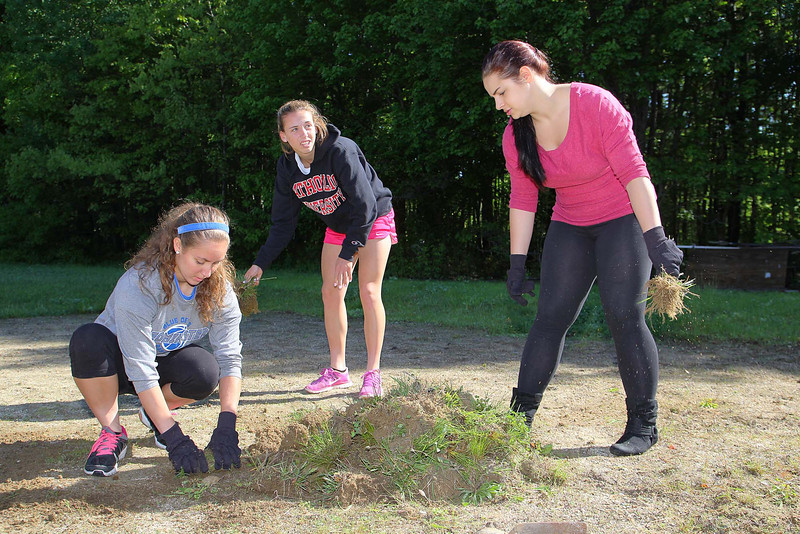 Every Mid-Wach school (Leominster, Fitchburg, Lunenburg, Oakmont, North Middlesex, Nashoba and many more) sent its athletic director and 2 or 3 student ambassadors to the Boys and Girls Club in Leominster to do volunteer work to help keep the club looking good. working on getting the dirt out of the grass that was trimmed from the side of the volleyball court at the the club is Dayna Koweski a junior at Leominster High Scshool, Kendyl Finelli a junior at Algonquin High School. and Juliana Breton a sophomore at Gardner High School.  SENTINEL & ENTERPRISE/JOHN LOVE