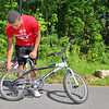 Every Mid-Wach school (Leominster, Fitchburg, Lunenburg, Oakmont, North Middlesex, Nashoba and many more) sent its athletic director and 2 or 3 student ambassadors to the Boys and Girls Club in Leominster to do volunteer work to help keep the club looking good. Checking to see if one of the bikes the club has was fixable is David Quaye a junior at Oakmont Regional High School. SENTINEL & ENTERPRISE/JOHN LOVE