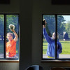 Every Mid-Wach school (Leominster, Fitchburg, Lunenburg, Oakmont, North Middlesex, Nashoba and many more) sent its athletic director and 2 or 3 student ambassadors to the Boys and Girls Club in Leominster to do volunteer work to help keep the club looking good. Washing windows is Erin Stephenson of Leominster High School and Alexa Conlin of Westboro High School. SENTINEL & ENTERPRISE/JOHN LOVE