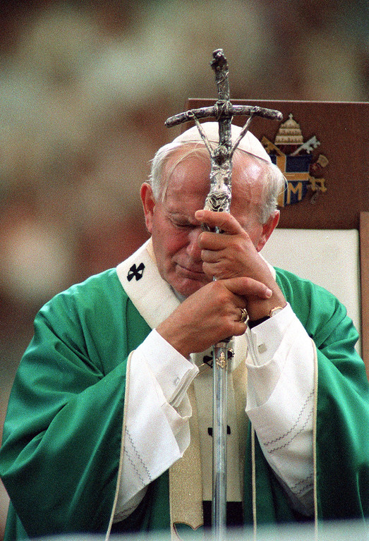 . Pope John Paul II in deep prayer during his appearance at the Pontiac Silverdome on  9-19-1987.