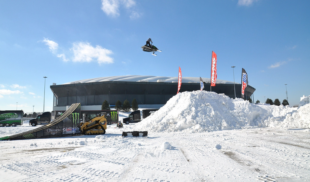 . Jeff Mullin of Ontario, jumps his snowmobile outside the Pontiac Silverdome, to promote the AMSOIL Championship Snocross Series (ACSS) racing event on Saturday Feb. 12, 2011 when the world�s top snowmobile racers will get after it on an indoor snocross racetrack.