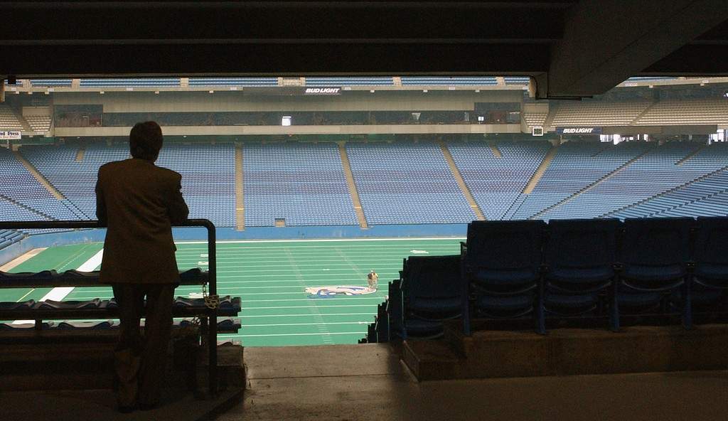 . A interested developer looks over the playing field of the Detroit Lions, former tenants of the Pontiac Silverdome during a walking tour of the faculity on Monday. The city of Pontiac and Pontiac Silverdome officals are soliciting offers for the property, since the Detroit Lions vacated the property for their new $315 million indoor venue located in down town Detroit.