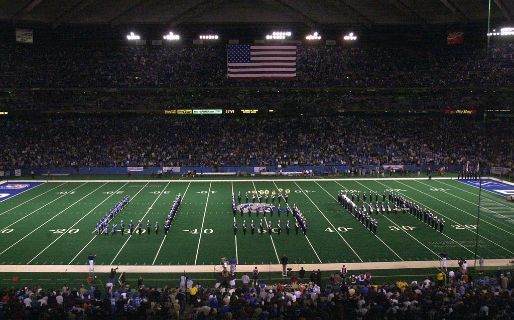 """. During pregame festivities of the Lions/Rams game, a marching band forms the letters \""""USA\"""", as God Bless America was sung, Monday, October 8, 2001, at the Pontiac Silverdome"""