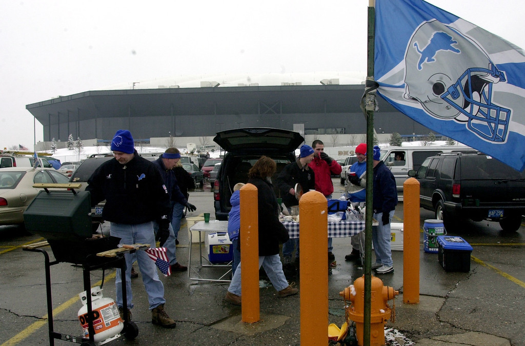. Bill Klotz, far left, of Troy tailgate with friends and family in the parking lot of the Pontiac Silverdome prior to the start of Sunday\'s game against the Dallas Cowboys at the Pontiac Silverdome. The Lions won 15-10 over Dallas to end the season and their final game played at the Silverdome.