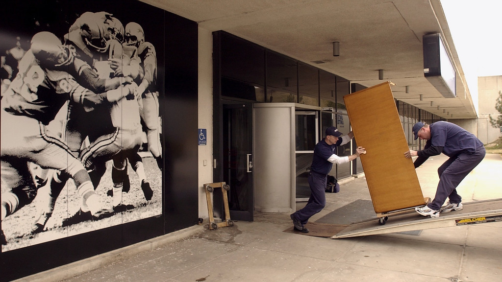 . Kevin Miller, left and Kevin Light drivers from Corrigan Moving Systems move office items out of the Detroit Lions office at the Pontiac Silverdome. After playing 30 miles north of Detroit for 27 years, the Lions will return downtown next season to plat at Frod Field, a new $315 million indoor venue that will host the 2006 Super Bowl.