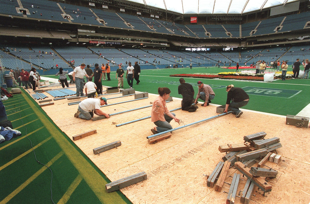 . Jehovah\'s Witness work crews work on the Silverdome floor setting up for their annual conference set for this weekend.