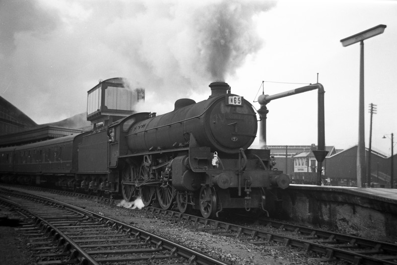 61167, of Mexborough Shed, losing its feet restarting a northbound express, Bristol Temple Meads, August 18, 1963.