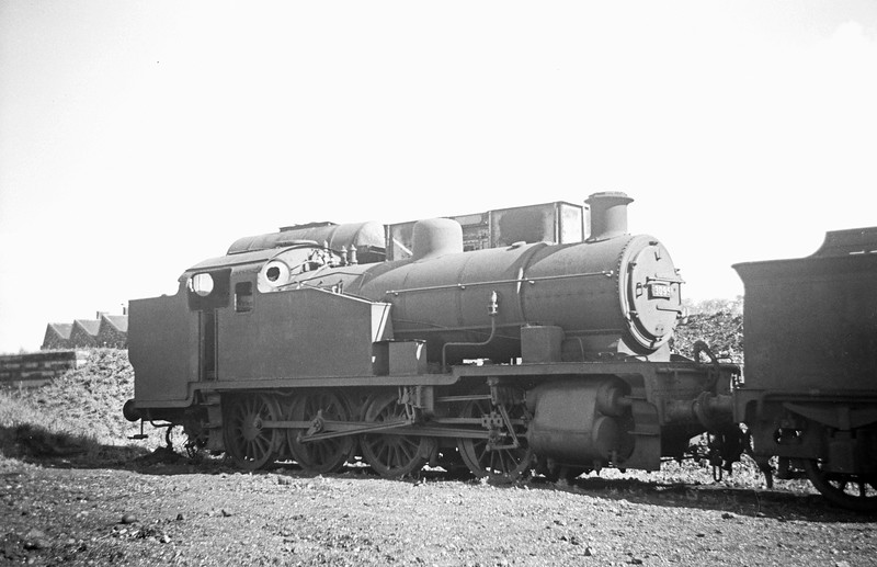 30951, stored for scrapping behind the coaling plant at Exeter St David's Shed, September 7, 1963. The front numberplate of this loco mysteriously disappeared shortly after this photograph was taken.