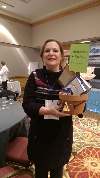 """Cindy Cormack, a raffle winner, takes home a decorative flower pot titled """"Inspiration Reflection."""""""