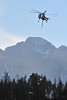 A Sikorsky S-64 Skycrane loops back to refill it's water tank in Rocky Mountain National Park on Monday. The heavy helicopter can carry 2,650 gallons of water and cruise at 105 mph.