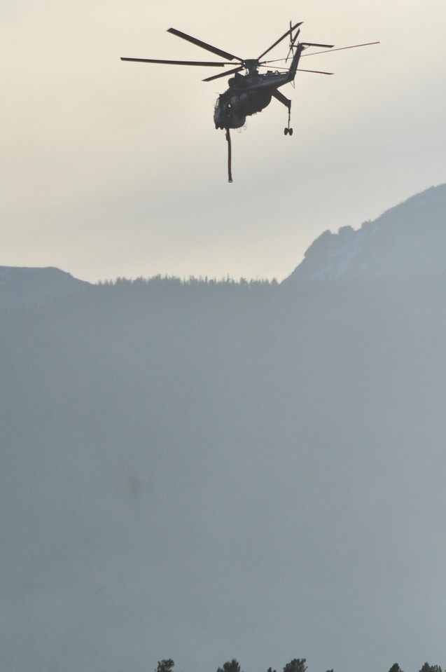 A sky crane helicopter faries another load of water to the Fern Lake Fire on Monday. The big type-1 helicopters were vital in the efforts to stop the blaze's spread.