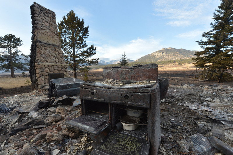Corningware and a chimny are all that remain of a cabin lost early Saturday morning to the resurgent Fern Lake Fire. This was the only structure lost when the fire roared out of the canyon and quickly spread east through Moraine Park.
