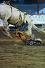 Walt Hester | Trail Gazette<br /> Saddle bronc rider Justin Browning of Sulpher. La., has a bad reride during Thursday's Rooftop Rodeo. Browning was able to leave the arena under his own power after getting hung up in his rigging, then getting stomped by his horse.