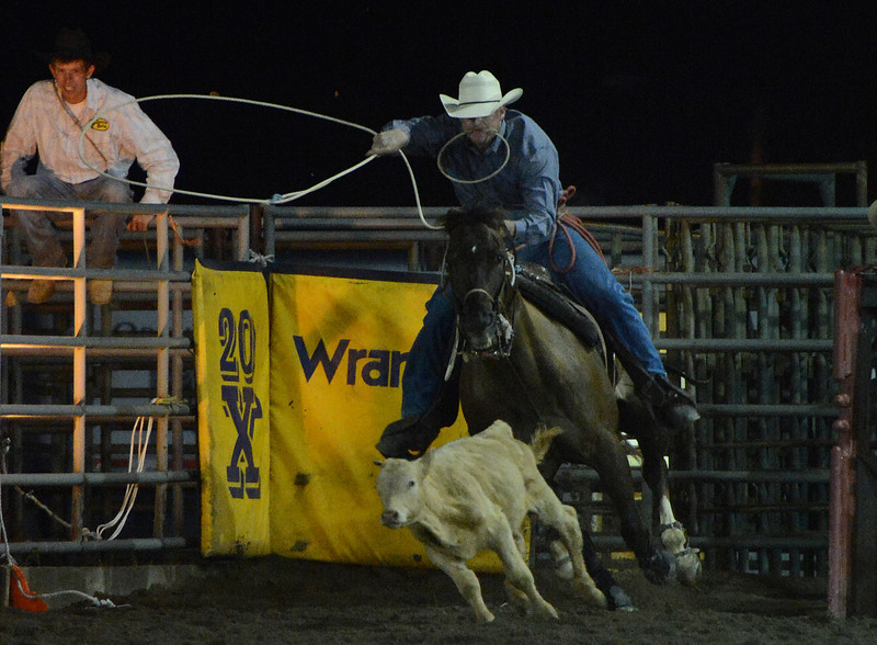 Walt Hester | Trail-Gazette<br /> A calf roper takes off on Tuesday. Seth Childers of Cameron, Texas, won the Tuesday night go-round, while Brice Ingo won on Wednersday night.