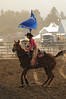 Walt Hester | Trail-Gazette<br /> Rooftop Rodeo's Lady-in-Waiting, Michelle Claypool, carries on in Wednesday's rain. The showers were brief and did not dampen the enthusiasm of the croud or contestants.
