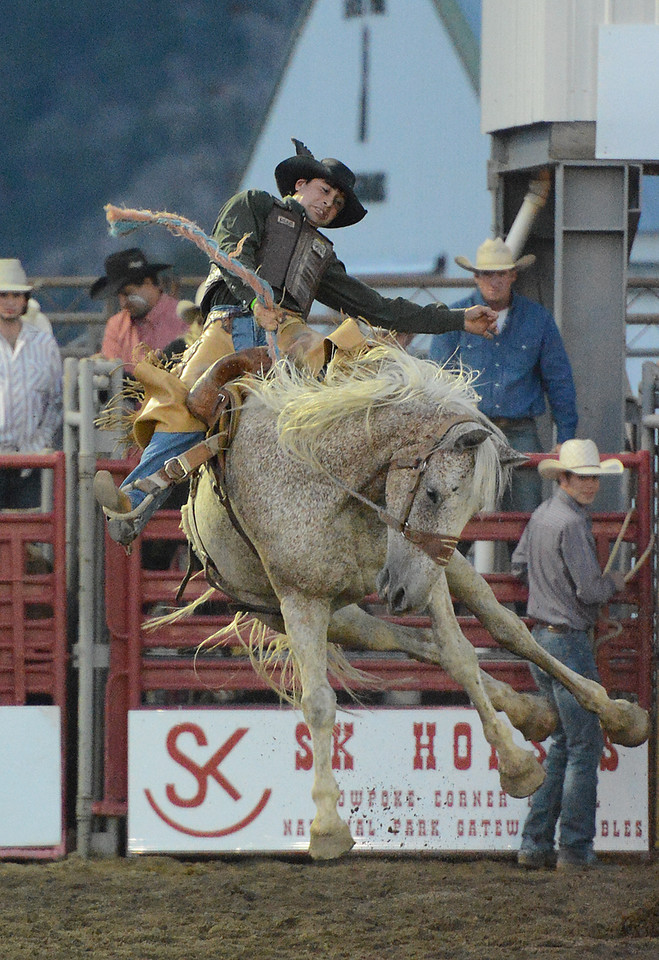 Walt Hester | Trail-Gazette<br /> Chuck Schmidt of Keldron, SD, holds on during Saddle Bronc competition on Tuesday. The saddle in the competition has no saddle horn, and the riders get to hold on with a thick rope.
