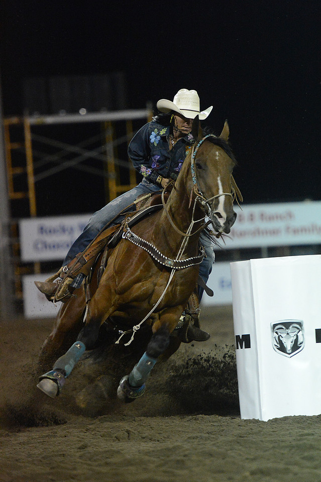 Walt Hester | Trail-Gazette<br /> Sarah Kieckhefer of Prescott, Ariz., makes the last turn during Barrel Racing on Tuesday. Kieckhefer won the first night with a time of 17.89 seconds.