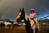 Walt Hester | Trail-Gazette<br /> Rooftop Rodeo Queen for 2012, Alex Hyland, sit beneath Wednesday's rainbow at the rodeo. The show continues through Sunday at the Stanley Fairgrounds.