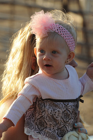 Walt Hester | Trail-Gazette<br /> Oakley Forbes of Pine Bluff, Wyo., enjoys her night at the rodeo on Tuesday. Weather has been warm, though Wednesday saw a passing shower.