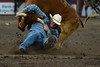 Walt Hester | Trail Gazette<br /> Brian Snell of Carpenter, Wyo., tries to turn his steer during Friday's Rooftop Rodeo. A steer wrestler can't just knock a steer down, but has to change the momentum of the animal.